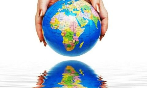 two hands holding a globe isolated on white
