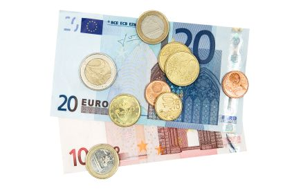 Euro coins and banknotes isolated on a white background.
